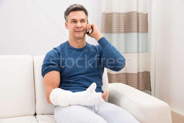 Disabled Man Talking On Cellphone Stock photo © AndreyPopov