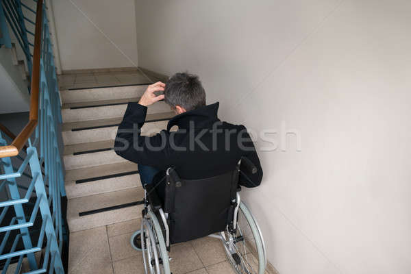 Worried Disabled Man In Front Of Staircase Stock photo © AndreyPopov