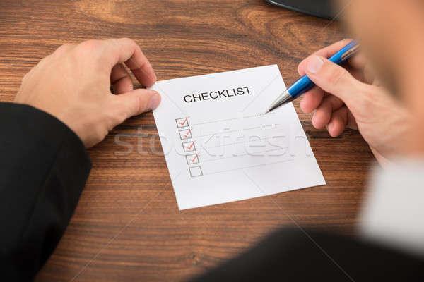 Person's Hand Filling Checklist Stock photo © AndreyPopov