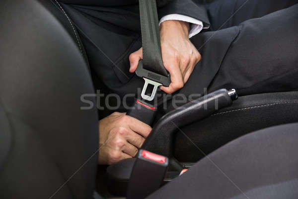 Man Fastening Seat Belt In Car Stock photo © AndreyPopov
