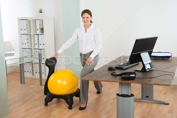 Empresária pilates bola cadeira jovem Foto stock © AndreyPopov