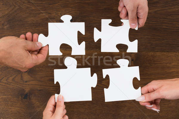 Human Hands Connecting Puzzle Piece Stock photo © AndreyPopov