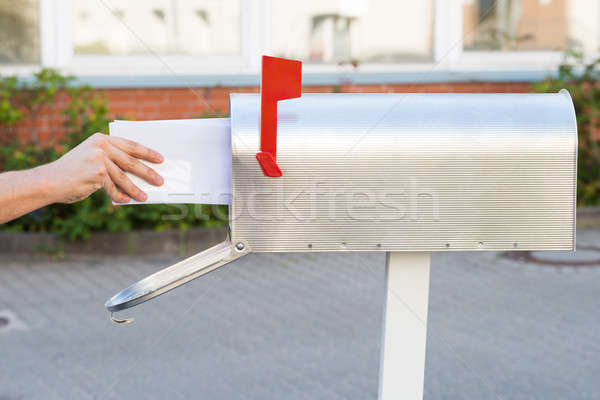 Person Removing Letters From Mailbox Stock photo © AndreyPopov