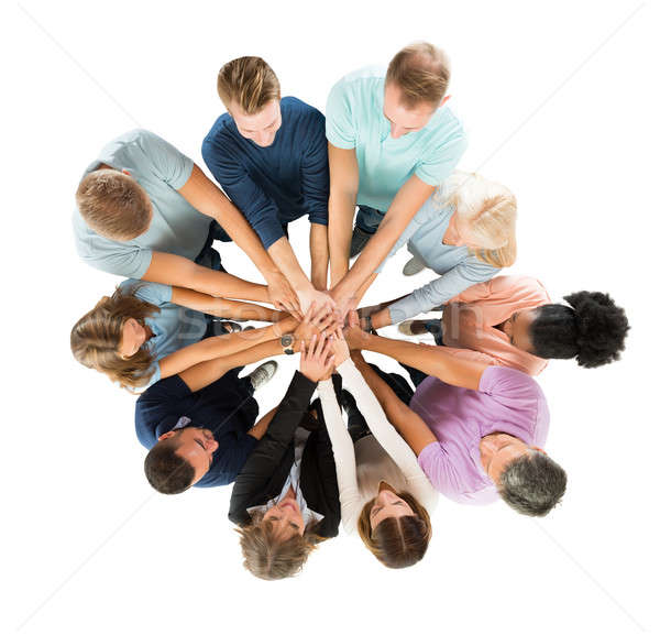 Creative Business People Stacking Hands In Huddle Stock photo © AndreyPopov
