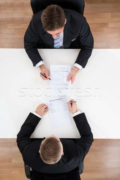 Businessman Taking Interview Of Candidate At Desk Stock photo © AndreyPopov