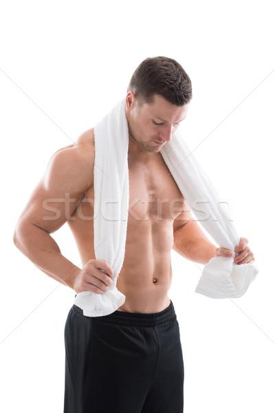 Starken Mann halten Handtuch herum Hals Stock foto © AndreyPopov