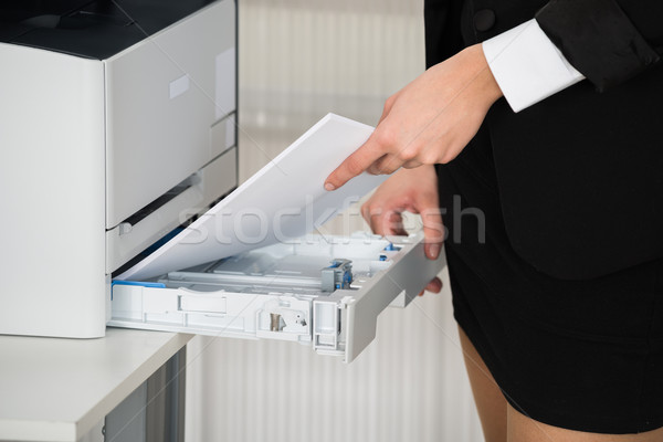 Businesswoman Inserting Papers In Photocopy Machine Stock photo © AndreyPopov