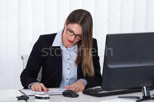 Businesswoman Analyzing Financial Report Stock photo © AndreyPopov