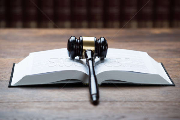 Mallet On Open Legal Book In Courtroom Stock photo © AndreyPopov