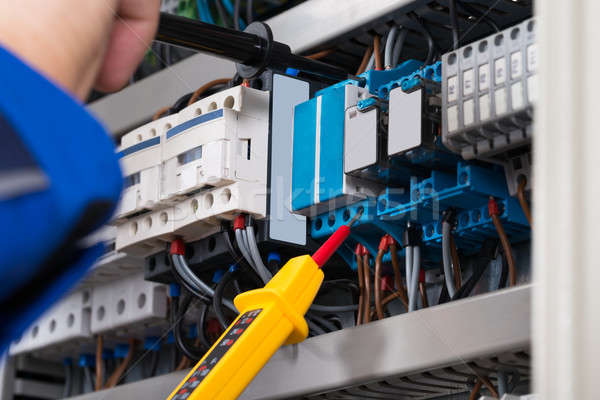 Male Electrician Checking Fusebox Stock photo © AndreyPopov