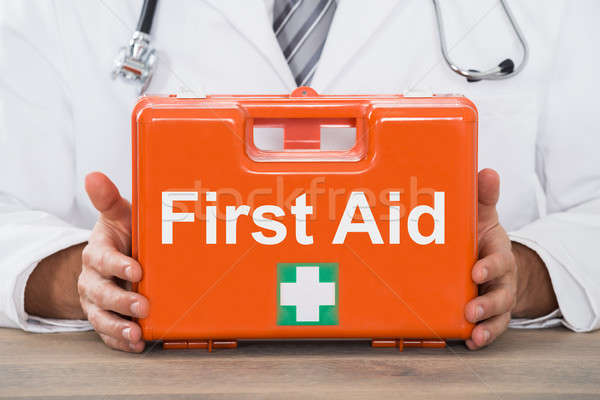 Doctor Hand Holding First Aid Kit Box Stock photo © AndreyPopov