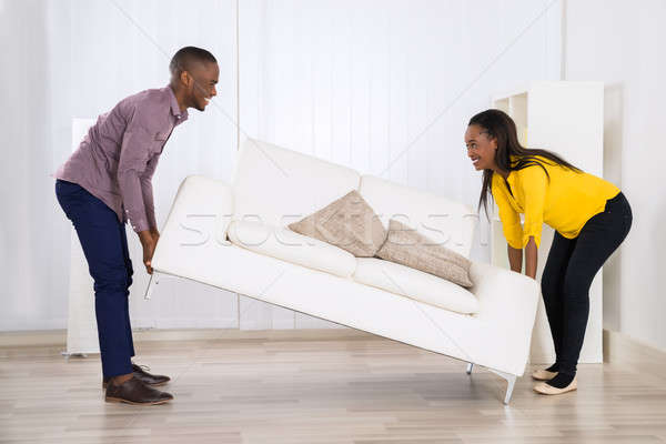 Couple Placing Sofa In Living Room Stock photo © AndreyPopov