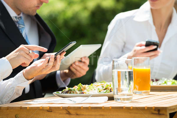 Businesspeople Using Mobile Phone Stock photo © AndreyPopov