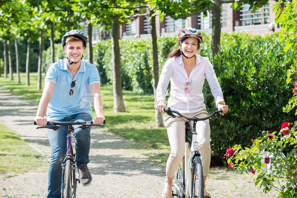 Smiling Couple Riding On Bicycles In The Park Stock photo © AndreyPopov