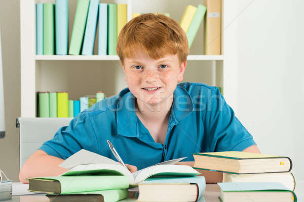 Happy Boy Studying In Library Stock photo © AndreyPopov