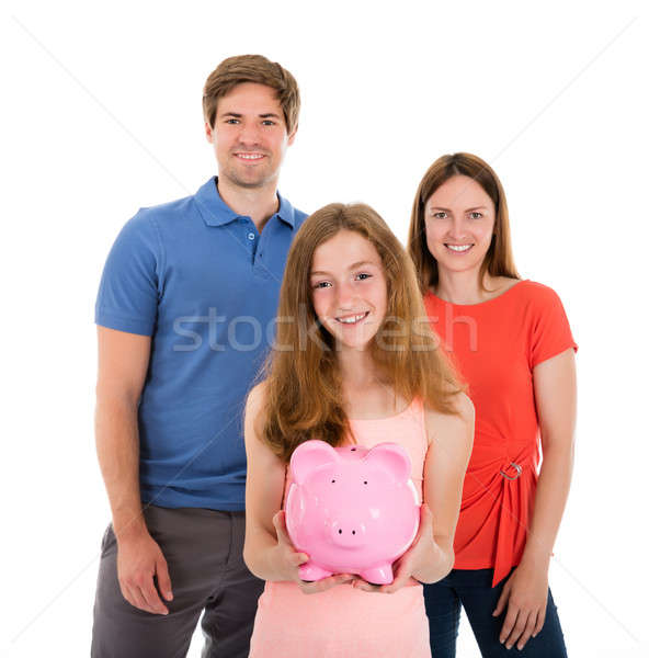 Parent With Her Daughter Holding Piggybank Stock photo © AndreyPopov