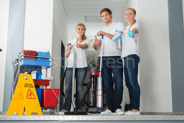 Group Of Happy Young Janitor Showing Thumbs Up Stock photo © AndreyPopov