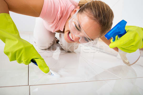 Stressed Woman Removing Stain On The Floor Stock photo © AndreyPopov