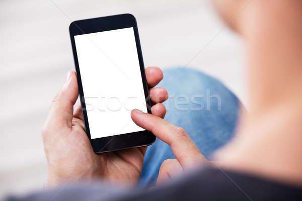 Man's Hand Holding Cell Phone With Blank Screen Stock photo © AndreyPopov