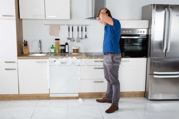 Man Shocked On Seeing Foam Coming Out Of Dishwasher Stock photo © AndreyPopov