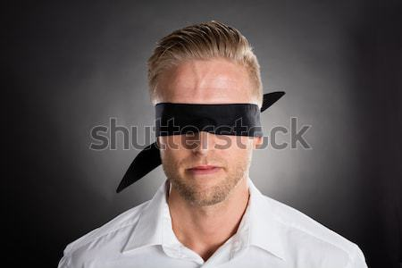Businessman With A Black Blindfold Over Eyes Stock photo © AndreyPopov