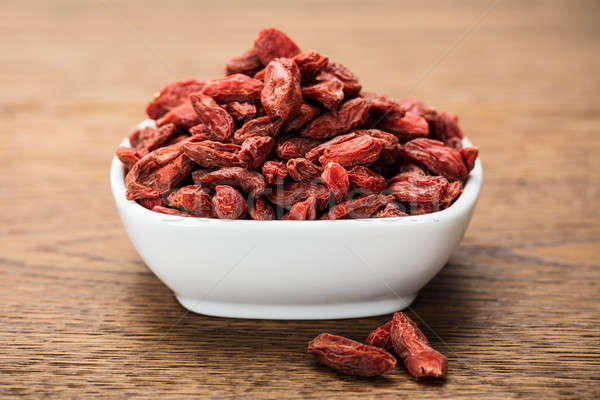 Goji Berries In White Bowl Stock photo © AndreyPopov