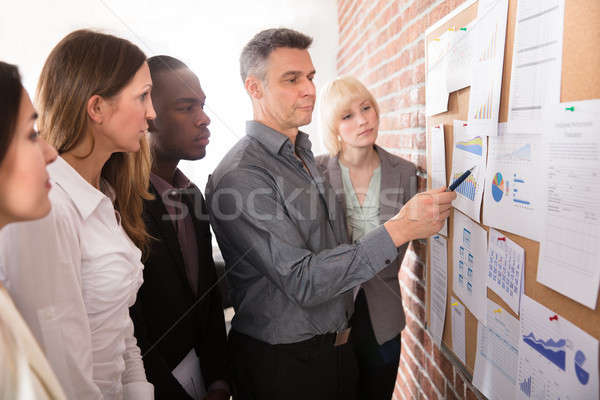 Manager Analyzing The Graph With His Colleague Stock photo © AndreyPopov
