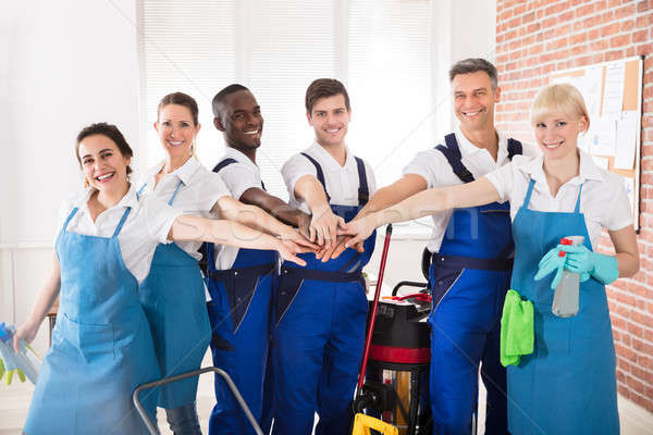 Smiling Diverse Janitors Stacking Hands Stock photo © AndreyPopov