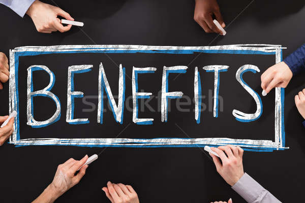 Pessoas escrita benefícios lousa saúde Foto stock © AndreyPopov