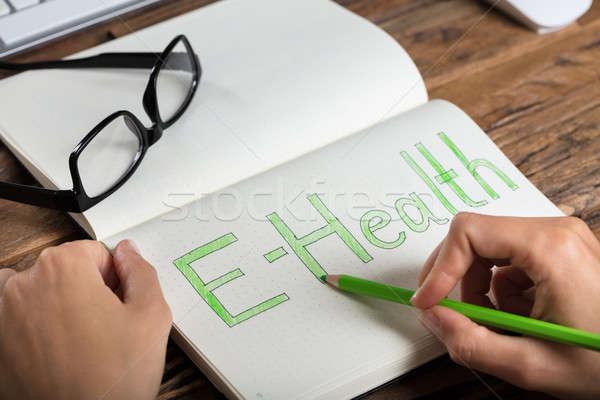 Businessperson Drawing E-health Concept Stock photo © AndreyPopov
