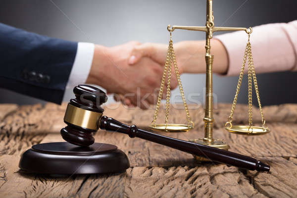 Close-up Of A Gavel And Scale On Wooden Desk Stock photo © AndreyPopov