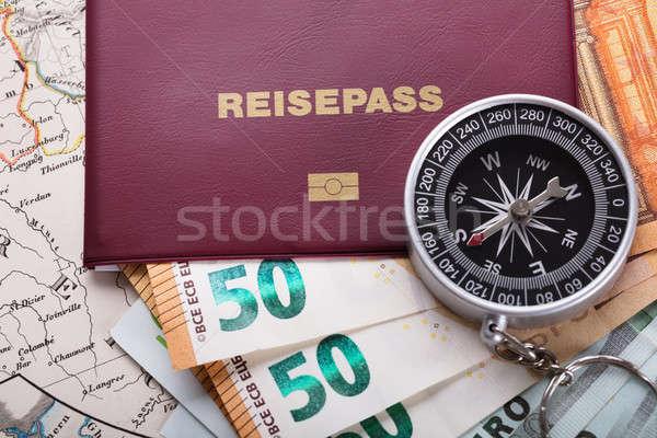 Pasaporte moneda notas brújula mapa Foto stock © AndreyPopov
