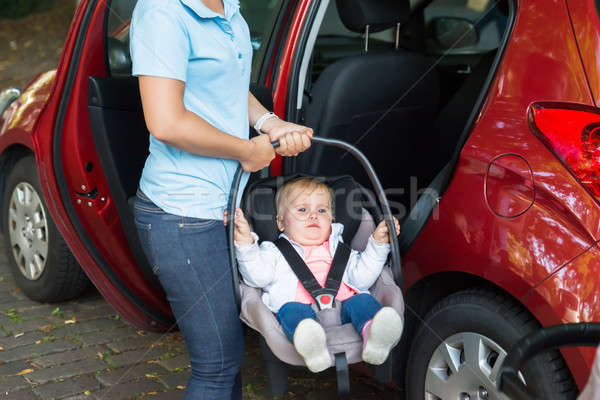 Mother Carrying Baby On Car Seat Stock photo © AndreyPopov