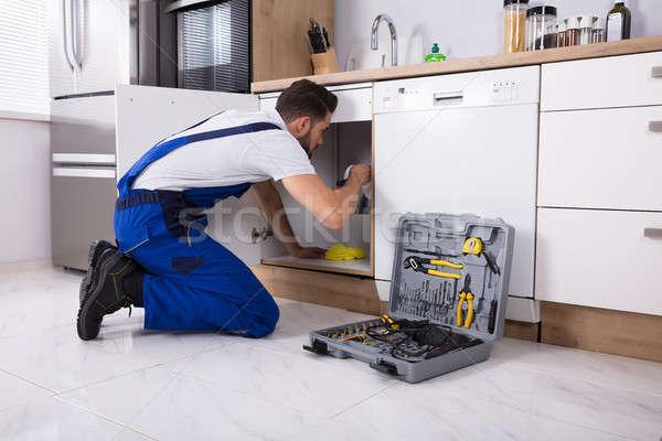 Plumber Repairing Sink Pipe Stock photo © AndreyPopov