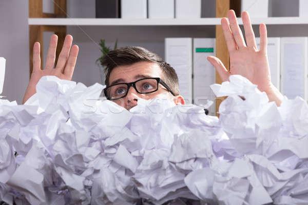 Geschäftsmann hinter Heap Papier tragen Stock foto © AndreyPopov