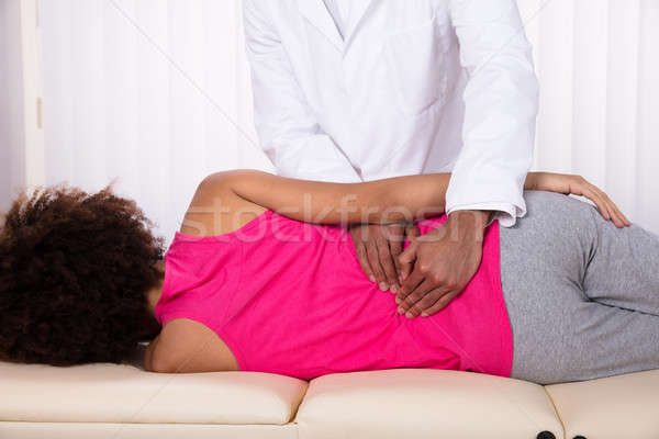 Physiotherapist Massaging Female Patient's Back Stock photo © AndreyPopov