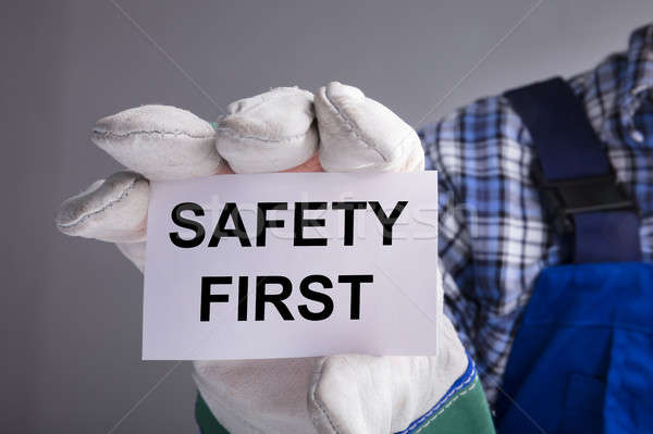 Workman Showing Safety First Sign Stock photo © AndreyPopov
