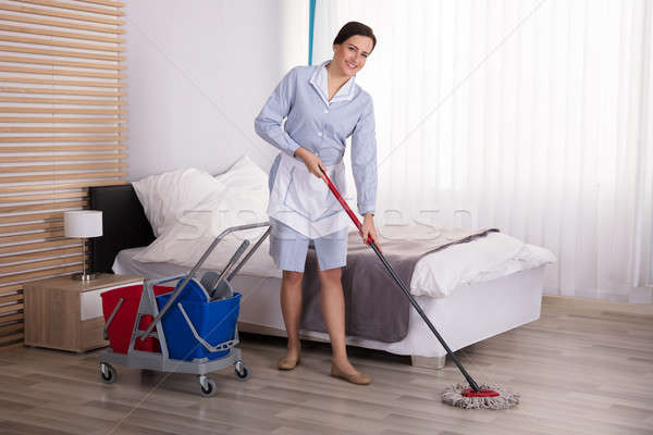 экономка очистки полу спальня молодые женщины Сток-фото © AndreyPopov