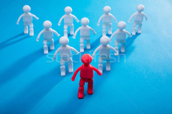 Red Human Figure Leading Team Toward Success Stock photo © AndreyPopov