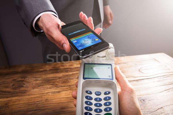 Betalen smartphone technologie hand Stockfoto © AndreyPopov