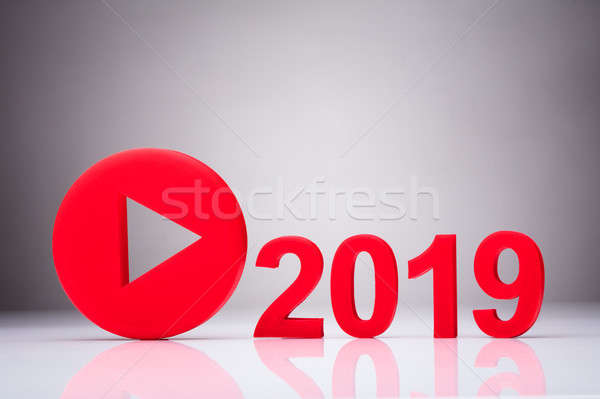 Play Icon Besides Year 2019 Stock photo © AndreyPopov