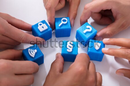 People Holding Red Cubic Blocks With Vivid Icons Stock photo © AndreyPopov