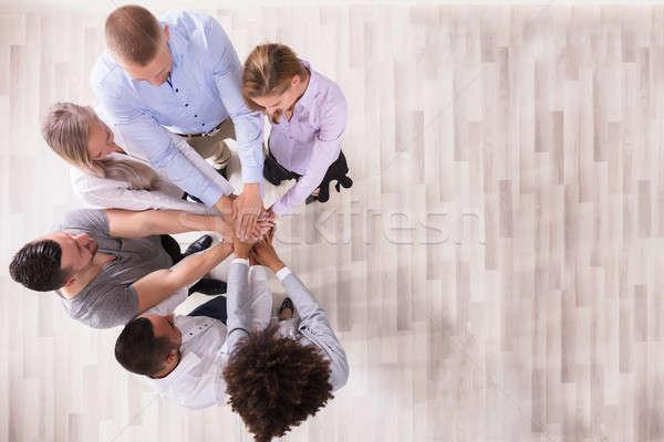 Equipe mãos ver negócio escritório Foto stock © AndreyPopov