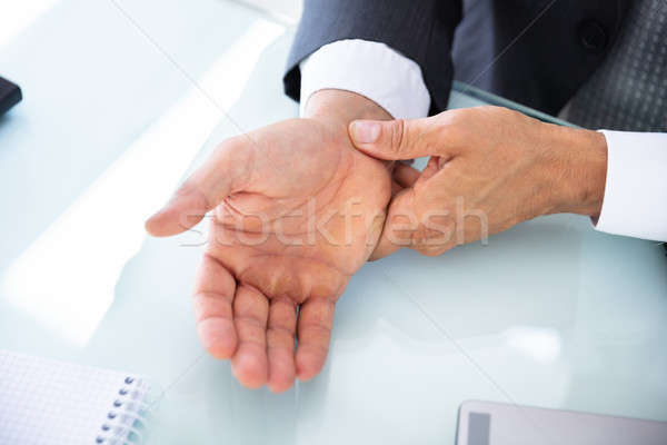 Businessman Holding Painful Wrist Stock photo © AndreyPopov