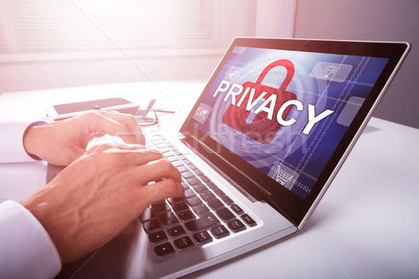 Businessman Configuring Privacy Settings In A Laptop Stock photo © AndreyPopov