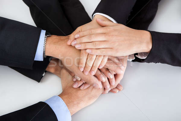 Business colleagues with hands stacked together Stock photo © AndreyPopov