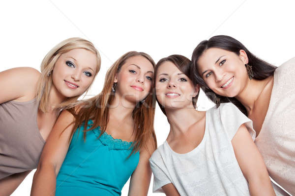 Four young woman looking down Stock photo © AndreyPopov