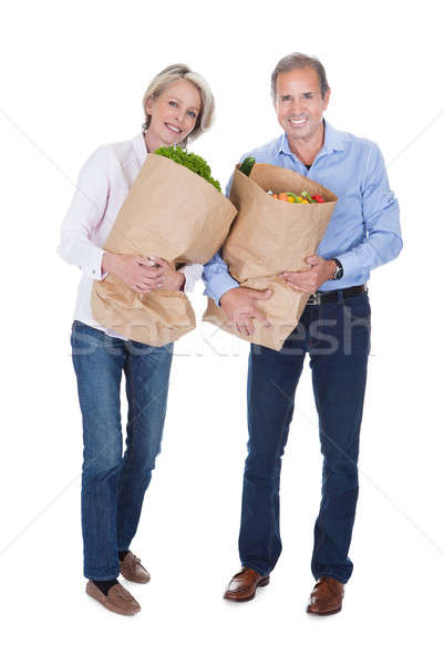 Mature Couple Holding Grocery Stock photo © AndreyPopov