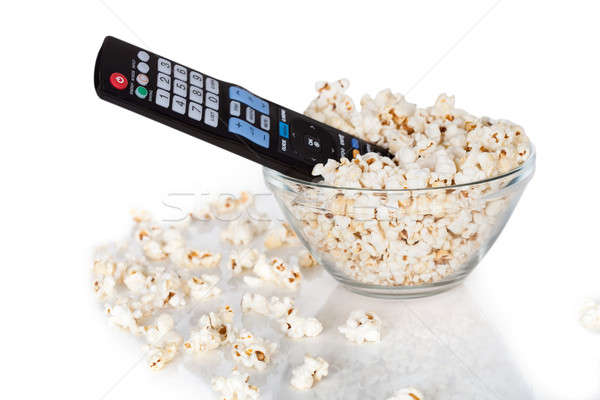 Close-up Of Remote Control In Bowl Of Popcorn Stock photo © AndreyPopov