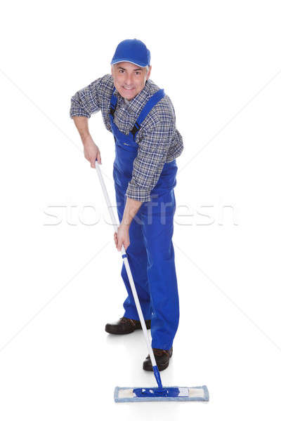 Mature Man Cleaning Floor With Mop Stock photo © AndreyPopov